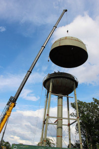 A crane from Western Crane Services of Bowling Green, Ky., raises the final, 30-ton piece of the Springville Utility District's 105-foot water tower into place Thursday afternoon.